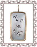 tag 3-C: large silver tag with gold rim